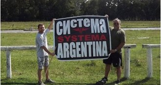 "People hold a poster ""Systema Argentina"""